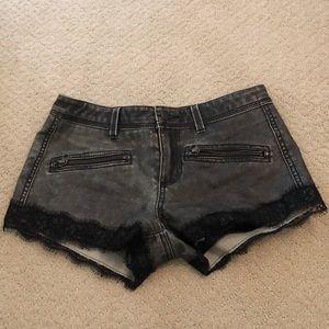 Free People black leather mini shorts.
